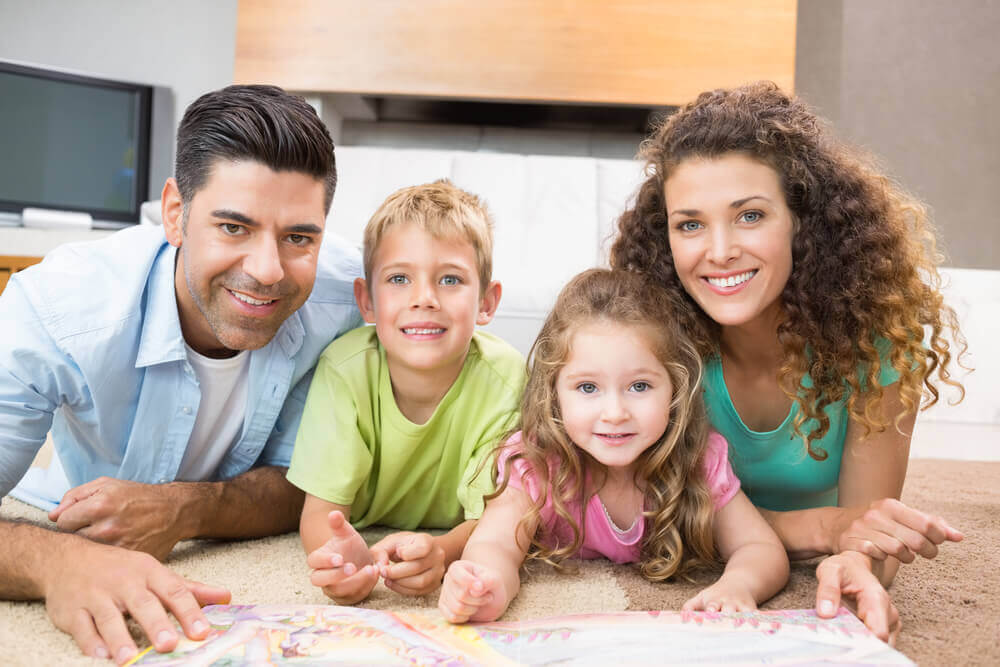 Family relaxing on cleaned carpet